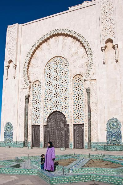 outside the Hassan II mosque on Morocco vacation